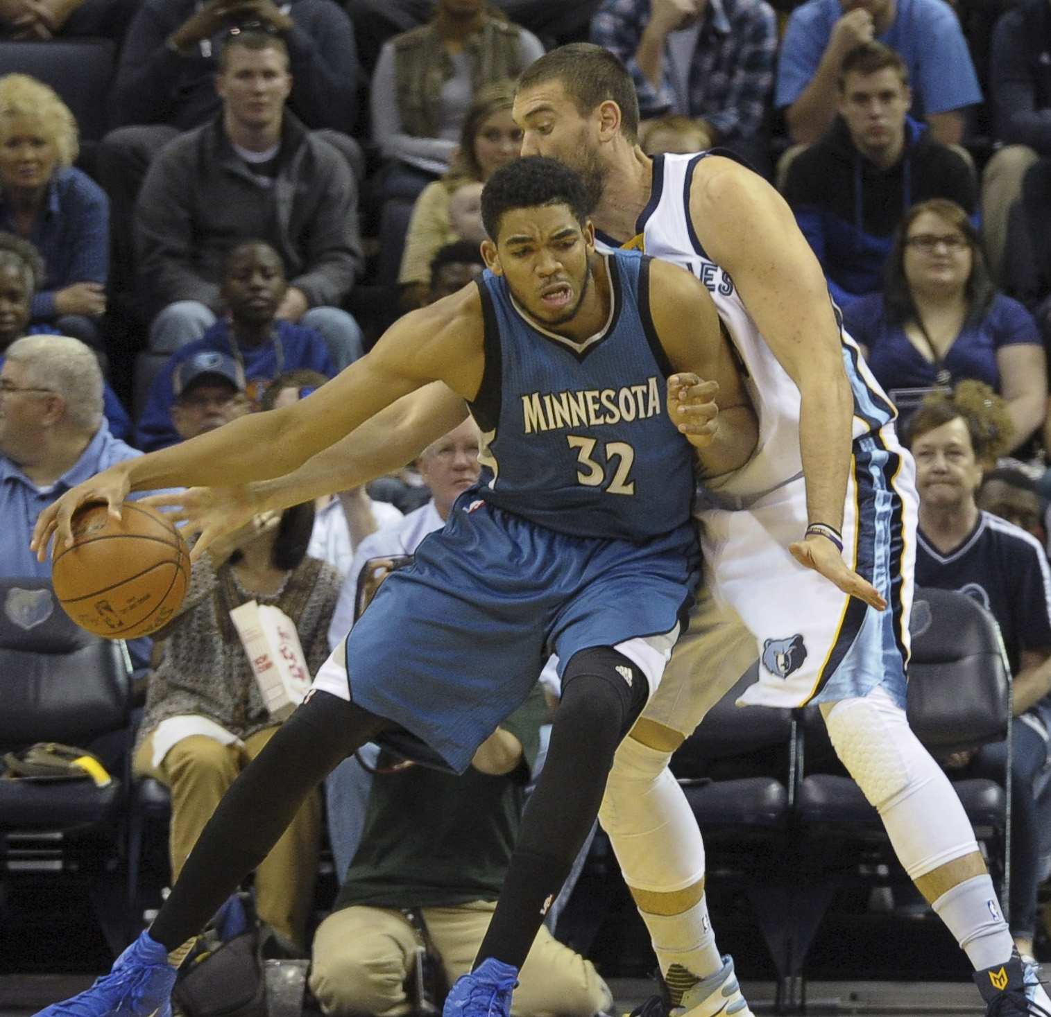 Oct 18, 2015; Memphis, TN, USA; Minnesota Timberwolves center Karl-Anthony Towns (32) handles the ball against Memphis Grizzlies center Marc Gasol (33) during the game at FedExForum. Mandatory Credit: Justin Ford-USA TODAY Sports